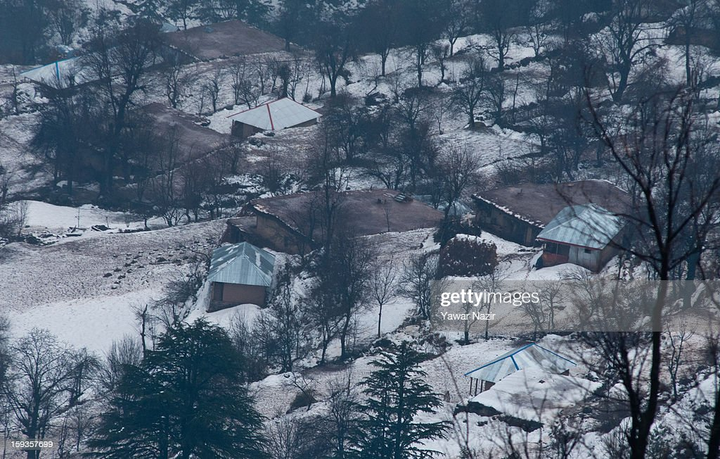 Residential houses and bunkers of the Pakistani army are seen on the Pakistan administered side of Kashmir from Churunda village on January 12, 2013, northwest of Srinagar, the summer capital of Indian Administered Kashshmir, India. The village with a population of a little over 12,000 people has been bearing the brunt of cross-fire between nuclear rivals India and Pakistan. Last week a Pakistan solider was killed across the Line of Control (LOC), a military line that divides Indian-administered Kashmir from the Pakistan-administered Kashmir at this village. People living along the LoC have continually been at risk due to hostility between the armies of the two rival nations. Last year, in November, three people, including a pregnant woman, had died after a shell fired from Pakistan landed on one of the houses in the village. Tension between Pakistan and India has escalated after a fresh skimirish along the border. Both countries have summoned each other's envoy to protest against unacceptable and unprovoked' attacks.