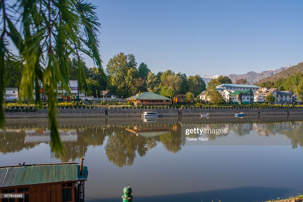 Residential houses are reflected on the waters of the river Jehlum on May 03, 2016 Srinagar, the summer capital of Indian administered Kashmir, India. Kashmir the Muslim majority state , is known as the 'Paradise on Earth' and has for centuries captured the imagination of many writers, poets and film makers and is integral to the tourist trade. Kashmir has been a contested land between nuclear neighbors India and Pakistan since 1947, the year both the countries attained freedom from the British rule.