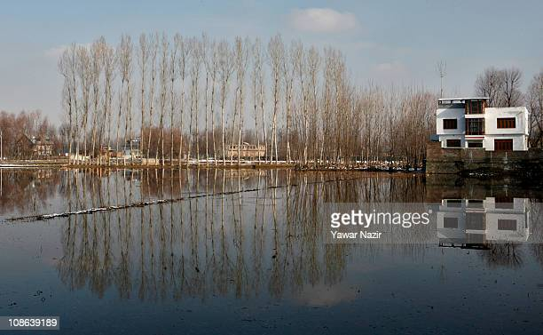 Residential houses are seen constructed on the banks of Narkara wetland on January 31 2011 in Srinagar the summer capital of Indian administered...