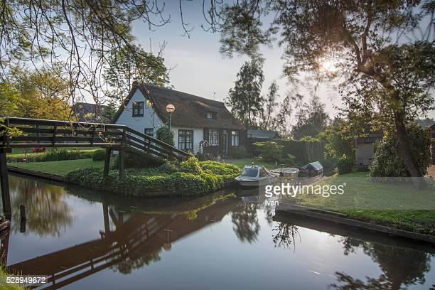 Residential Houses, Bridge and Boats In Giethoorn Village
