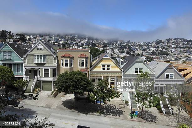 Residential houses line a street in Mission district near Delores Park as typical summer fog rolls in on July 4 2014 in San Francisco California San...