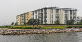 Residential low-rise buildings at shore of Finland Gulf in new district Herttoniemenranta of Helsinki, Finland