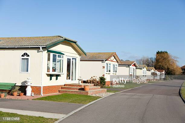 Residential mobile park homes sited in a row.
