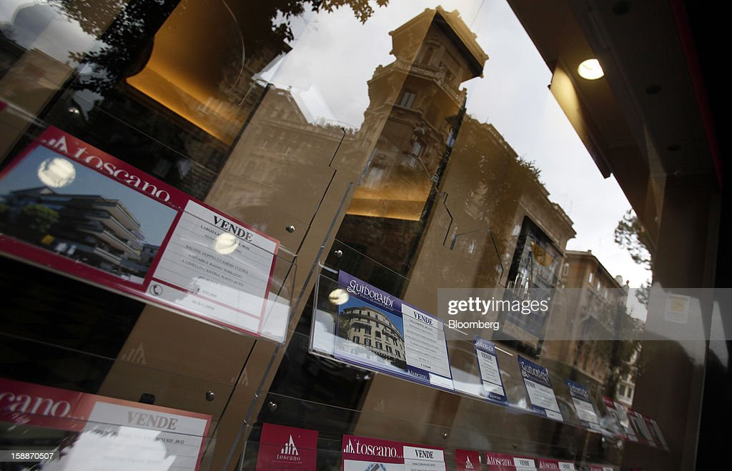 Residential properties are advertised for sale in the windows of an estate agent in the Coppede district of Rome, Italy, on Wednesday, Jan. 2, 2013. Italian property sales often are reported to be less than the actual price paid to reduce taxes or skirt controls on money laundering, according to the website of the finance police, which reports to Italian Finance Minister Vittorio Grilli. Photographer: Alessia Pierdomenico/Bloomberg via Getty Images