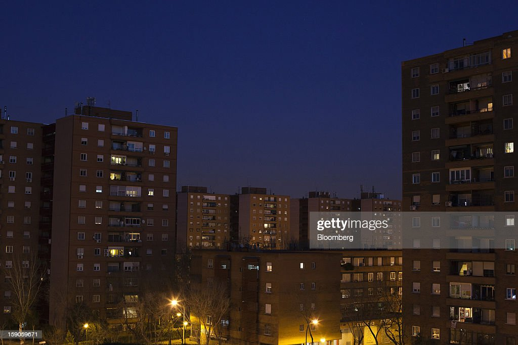 Residential properties are seen illuminated by electric lights at night in Madrid, Spain, on Friday, Jan. 4, 2013. In December, the Spanish parliament passed an energy law that imposed a 7 percent tax on electricity generation from Jan. 1 to plug the deficit. Photographer: Angel Navarrete/Bloomberg via Getty Images