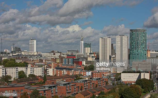Residential properties sit against a backdrop of the Birmingham city skyline in Birmingham UK on Wednesday Oct 6 2010 Planned cuts to UK public...