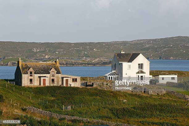Residential properties stand on the banks of East Loch Roug on the Isle of Lewis UK on Thursday Aug 7 2014 Scotland should adopt its own currency if...