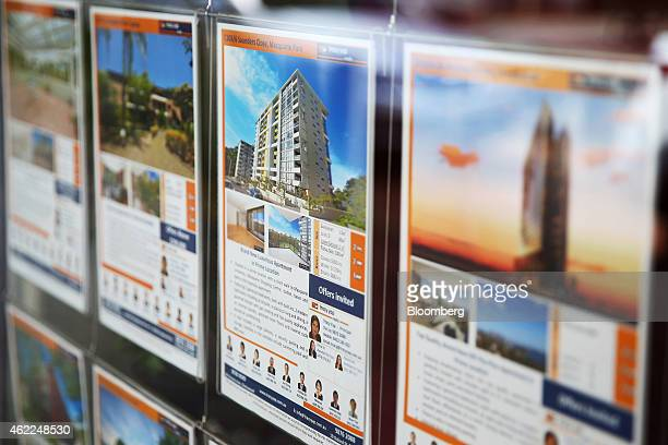 A residential property information leaflet advertising an apartment for sale is displayed in the window of a property agent in Sydney Australia on...