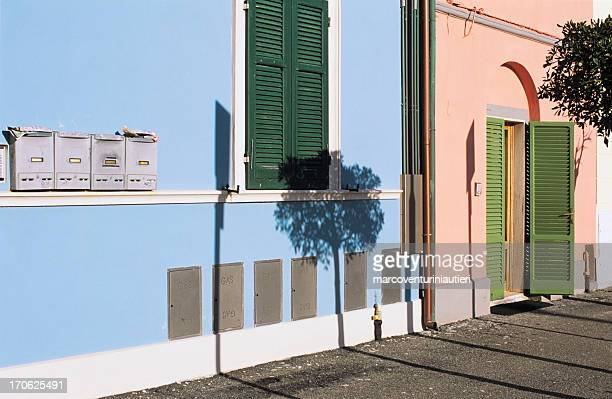 Residential sunny scene in Italy - home and mailboxes