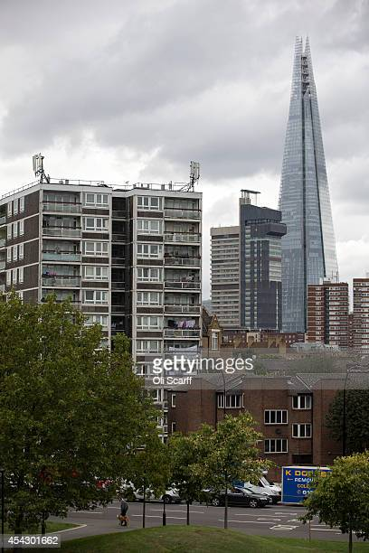 Residential tower blocks in an area of Southwark with a high concentration of social housing in front of the 'Shard' skyscraper on August 28 2014 in...