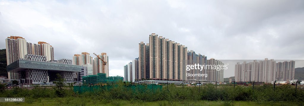 Residential tower blocks stand in the Tseung Kwan O area of the New Territories in Hong Kong, China, on Tuesday, Sept. 4, 2012. Hong Kong will boost the supply of homes and give preference to local buyers as it seeks to cool housing prices that have surged to the world's most expensive, fueled by record-low interest rates and Chinese investment. Photographer: Daniel J. Groshong/Bloomberg via Getty Images