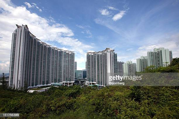 Residential tower blocks stand in the Tung Chung area of Lantau Island in Hong Kong China on Tuesday Sept 4 2012 Hong Kong will boost the supply of...
