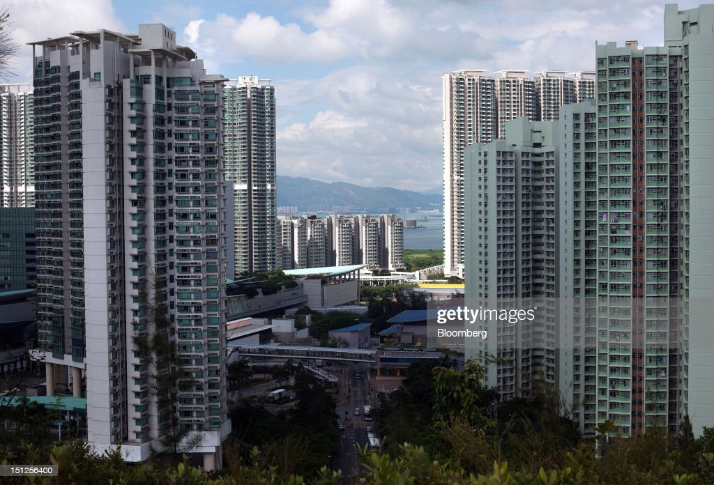 Residential tower blocks stand in the Tung Chung area of Lantau Island in Hong Kong, China, on Tuesday, Sept. 4, 2012. Hong Kong will boost the supply of homes and give preference to local buyers as it seeks to cool housing prices that have surged to the world's most expensive, fueled by record-low interest rates and Chinese investment. Photographer: Daniel J. Groshong/Bloomberg via Getty Images