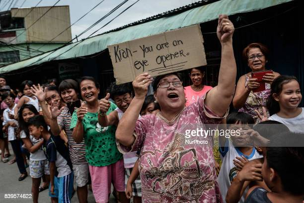 Residents and activists chant slogans during the funeral procession of Kian Loyd Delos Santos in Caloocan Metro Manila Philippines August 26 2017...