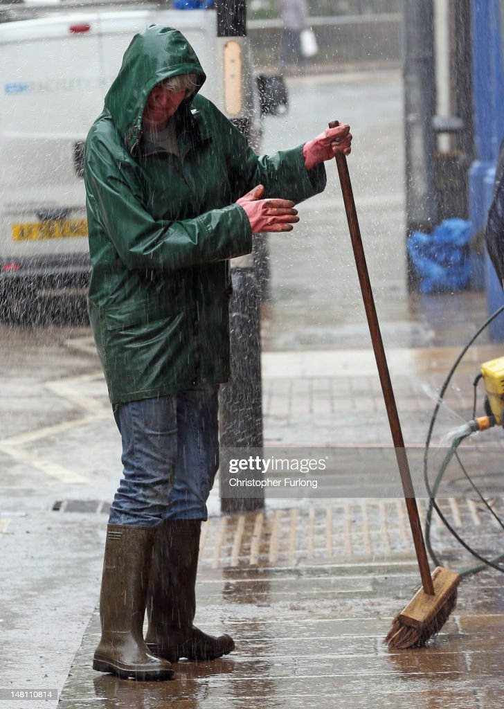 Residents and business owners clean up after flash foods on July 10, 2012 in Hebden Bridge, England. Hebden Bridge and the Calder Valley are clearing up again after being hit by floods for the third time in three weeks. Heavy rain overnight left many roads in the valley flooded as a month's worth of rain fell in less than an hour.