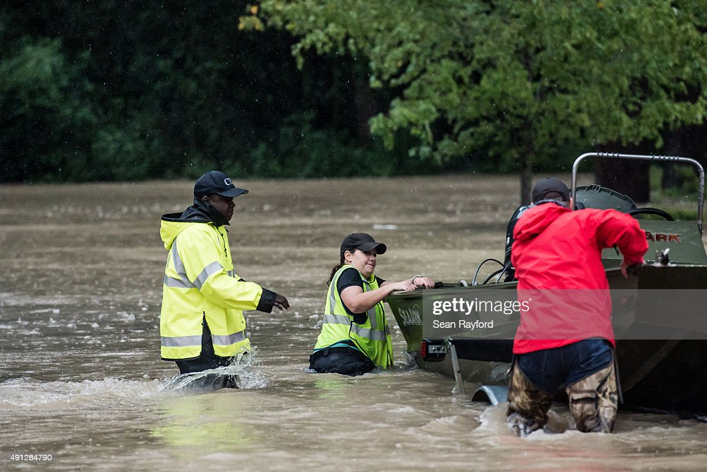 Residents and first responders launch boats to rescue people trapped in their homes October 4 2015 in Columbia South Carolina South Carolina...