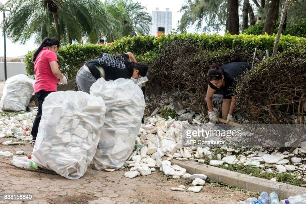 Residents and government workers pick up polystyrene and other rubbish in Heng Fa Chuen in Hong Kong on August 24 a day after Typhoon Hato created a...