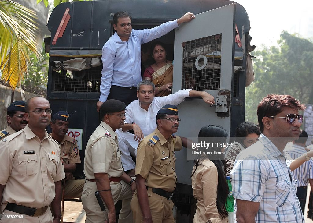 Residents and political leaders supporting the residents being taken into custody for creating obstruction during the demolition process at Campa Cola compound on November 12, 2013 in Mumbai, India. Seven high-rises were constructed at what is called the Campa Cola Compound, between 1981 and 1989. The builders had permission for only five floors, but constructed several more. One of the buildings, Midtown, has 20 floors. Another building, Orchid, has 17. The Supreme Court asked the BMC to investigate, and the civic body served demolition notices for all flats constructed above the fifth floor, which it said were illegal.