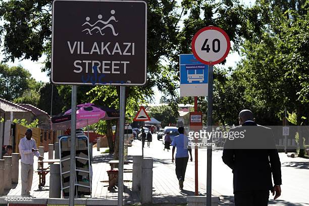 Residents and tourists walk along Vilakazi street in Soweto South Africa on Wednesday Nov 5 2014 Township economies have the potential to become an...