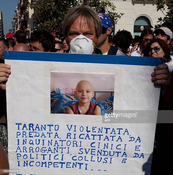 Residents and workers of the Ilva steelworks protest against pollution during a demonstration in the Italian southern city of Taranto on August 17...