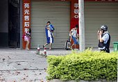 Residents are evacuated from the area of a damaged building after a blast occurred in the early morning in Liucheng a rural county of the Guangxi...