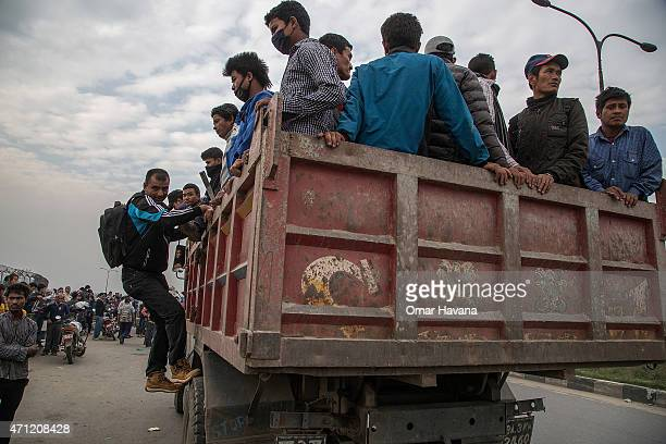 Residents are evacuated in a truck on April 26 2015 in Kathmandu Nepal A major 78 earthquake hit Kathmandu midday on Saturday and was followed by...