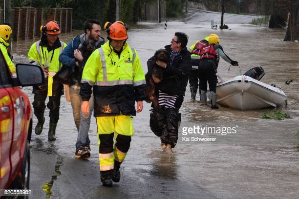 Residents are forced to evacuate their homes as rising waters cause flooding in Fifield Terrace in the suburb of Opawa on July 22 2017 in...