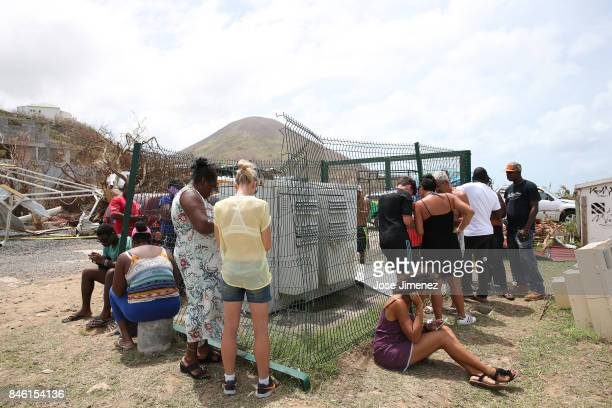Residents are seen at a mobile communication station taking advantage of a signal on September 12 2017 in French Cul de Sac Saint Martin The...