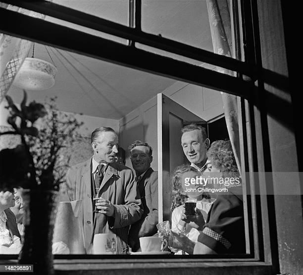 Residents at a party to celebrate the coronation of Queen Elizabeth II held in Morpeth Street in London's East End 2nd June 1953 Original publication...