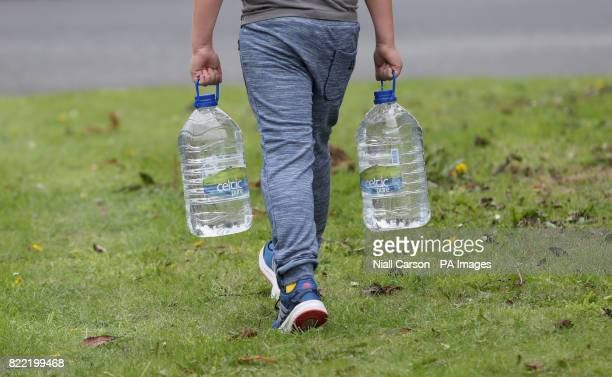 Residents at Termon Abbey in Drogheda carry water supplied by Drogheda council following a burst pipe