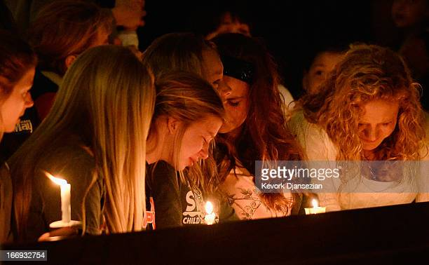 Residents attend a candelight vigil and prayer honoring the victims of West Fertilizer Company explosion at St Mary's Assumption Catholic Church...