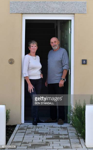 Residents Brian and Angela Kerr stand outside their home in Nansledan housing development championed by Britain's Prince Charles Prince of Wales at...