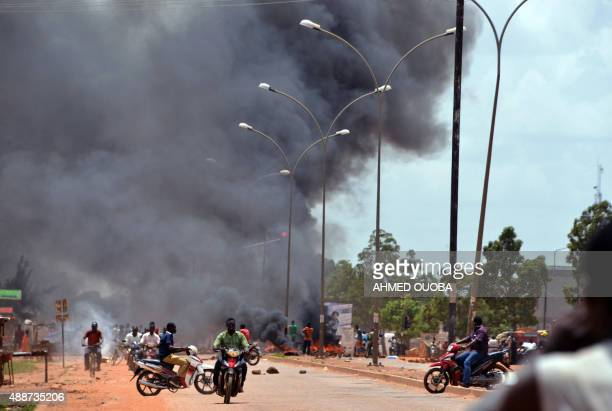 Residents burn tires along a street in Ouagadougou on September 17 after Burkina Faso's presidential guard declared a coup a day after seizing the...