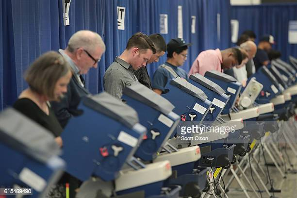 Residents cast ballots for the November 8 election at an early voting site on October 18 2016 in Chicago Illinois With three weeks to go until...