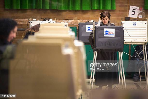 Residents cast their votes at a polling place on election day February 24 2015 in Chicago Illinois Chicago Mayor Rahm Emanuel is hoping to win...
