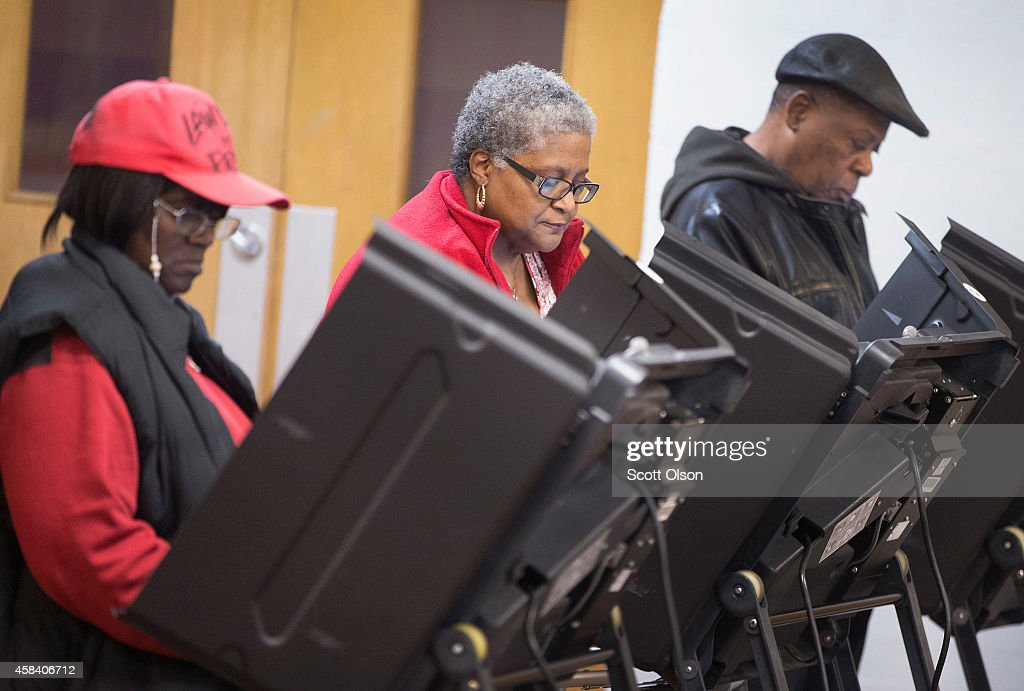 Residents cast their votes at a polling place on November 4 2014 in Ferguson Missouri In last Aprils election only 1484 of Ferguson's 12096...