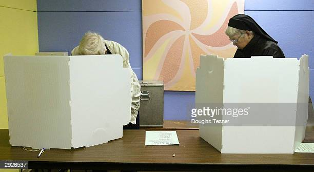 Residents cast their votes at the Octavia Fellin Public Library during the first ever New Mexico caucus February 3 2004 in Gallup New Mexico The...