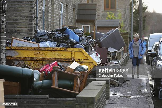 Residents clean up the damage caused by flood waters in the village of Elland Flood waters from the River Calder overflowed into the Calder and...