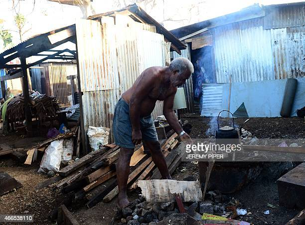 Residents clean up their homes in Vanuatu's capital Port Vila on March 17 2015 after Cyclone Pam ripped through the island nation The UN said that...
