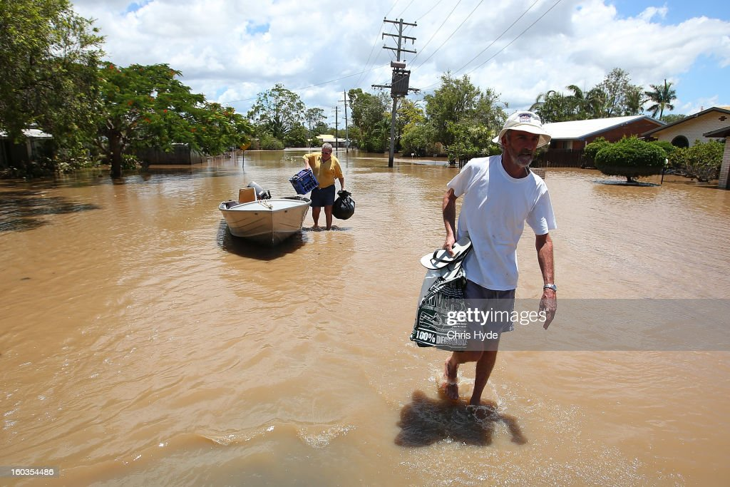 Residents collect belongings from their homes as parts of southern Queensland experiences record flooding in the wake of Tropical Cyclone Oswald on January 30, 2013 in Bundaberg, Australia. Flood waters peaked at 9.53 metres in Bundaberg yesterday and began receding overnight, as residents and relief teams prepare to clean-up debris. Four deaths have been confirmed in the Queensland floods and the search is on for two men thought to be missing in floodwaters in Gatton.