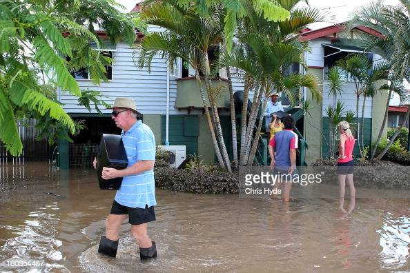 Residents collect belongings from their homes as parts of southern Queensland experiences record flooding in the wake of Tropical Cyclone Oswald on...