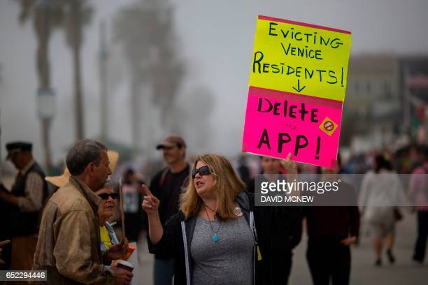 Residents demonstrate near a building converted into a Snap Inc vender of Spectacles sunglass cameras for Snapchat on the Venice Beach boardwalk on...