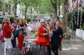 Residents drink champagne and enjoy the atmosphere during a street party on Niton Street on June 2 2012 in Fulham southwest London England For only...