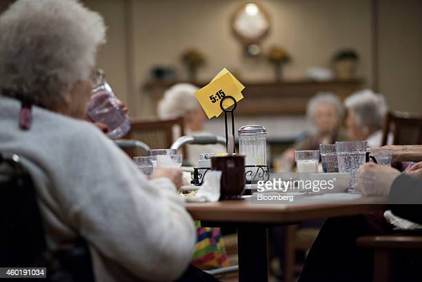 Residents eat breakfast in the dining room at Concord Care Center in Garner Iowa US on Thursday Oct 9 2014 Iowa state legislator Henry Rayhons is...