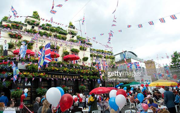 Residents enjoy a street party in Kensington during the Queen's Diamond Jubilee celebrations on June 4 2012 in London England For only the second...