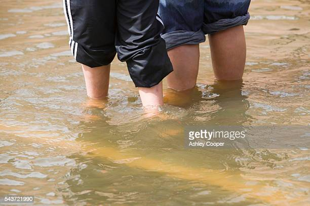 Residents escape the flood waters in Bentley near Doncaster South yorkshire during the unprecedented summer floods of June 2007 | Location Bentley...