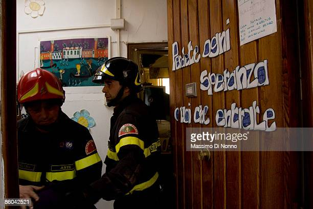 L' AQUILA APRIL 15 Residents escorted to firemen comeback in the own houses for to take the personal objects on April 15 2009 in L'Aquila Italy...