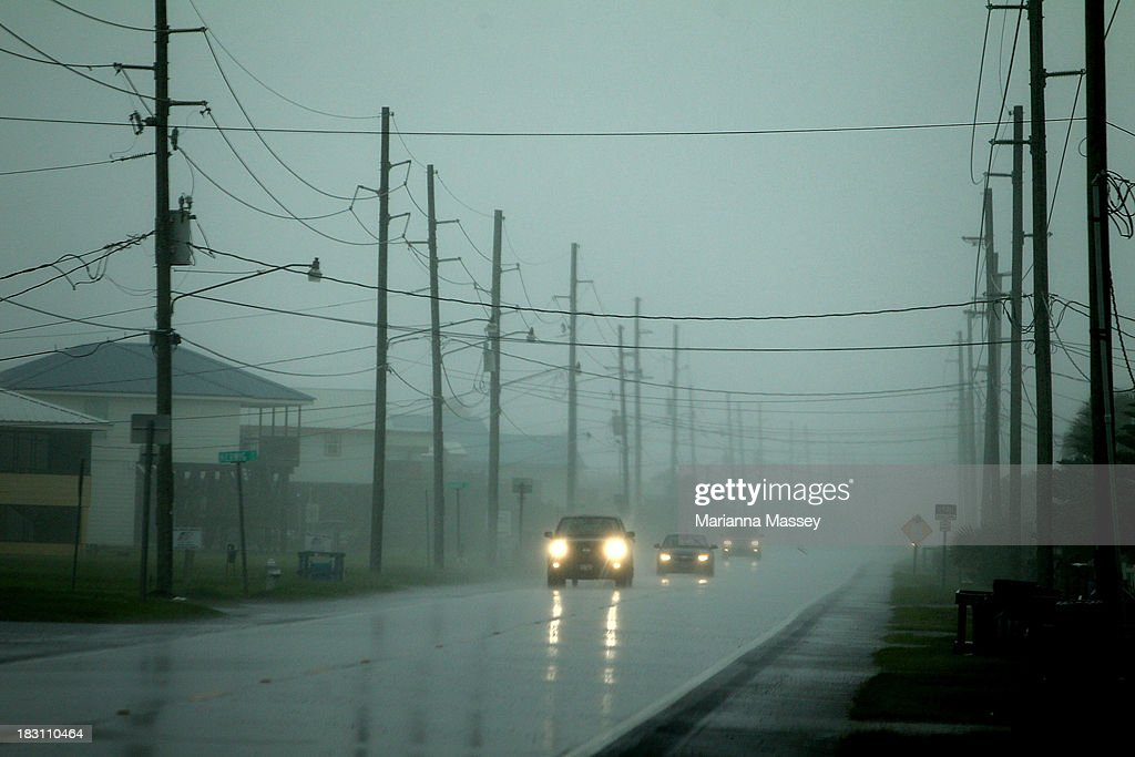 Residents evacuate as heavy rains and wind begin in Grand Isle ahead of Tropical Storm Karen on October 4, 2013 in Grand Isle, Louisiana. Louisiana authorities issued a mandatory evacuation of low-lying areas even as Tropical Storm Karen weakened while moving through the Gulf of Mexico.
