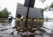Residents evacuate from flooding from Hurricane Isaac's storm surge on the north shore of Lake Ponchartrain on August 30 2012 in Slidell Louisiana...