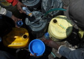 Residents fetch water in small bottles and jerrycans on March 22 2012 in the Mathare slum Nairobi where a water shortage continues to bite on World...